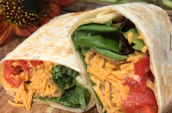 Veggie wrap in front of a sunflower bouquet