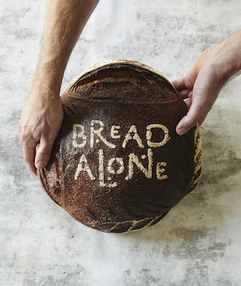 Bread Alone Bakery logo on a round loaf of bread