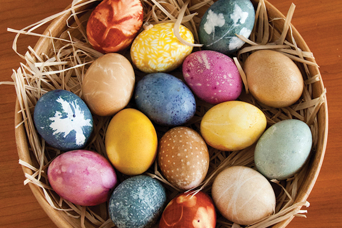 naturally colored easter eggs in a basket