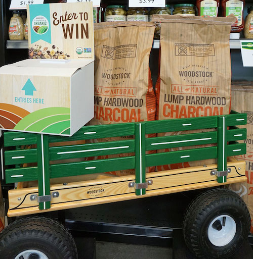 wooden wagon with two bags of Woodstock charcoal and box for raffle tickets