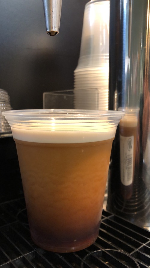 Close-up of a fresh-poured cup of Nitro Cold Brew at Honest Weight