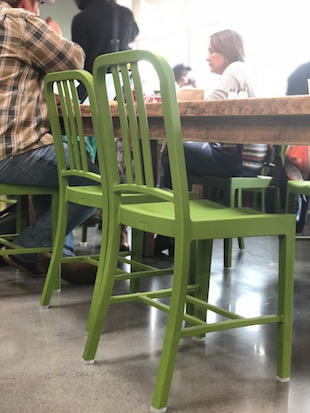Green chairs in Honest Weight's cafe