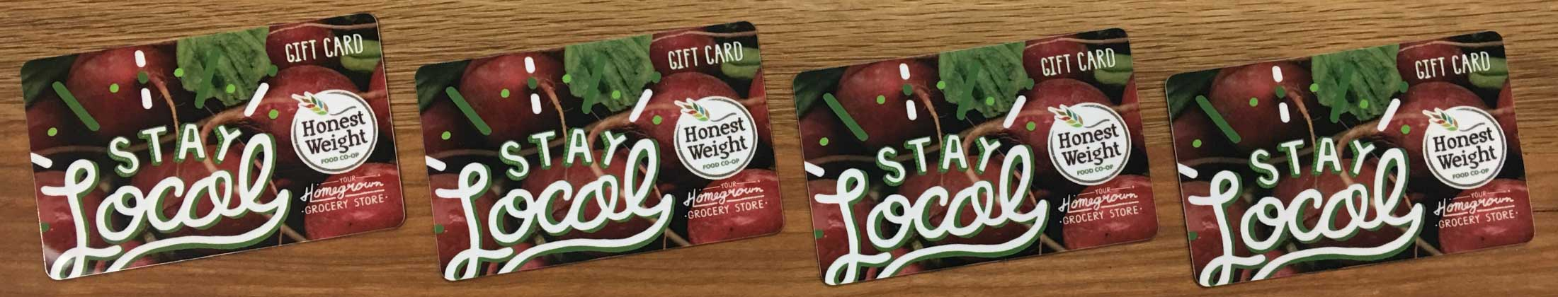 Honest Weight Gift Cards lined up on a wooden background