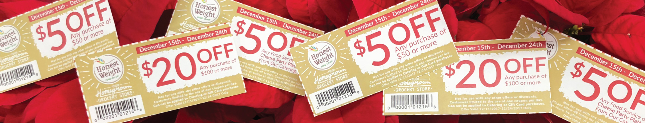 Coupons cut out and laid across a red cloth background