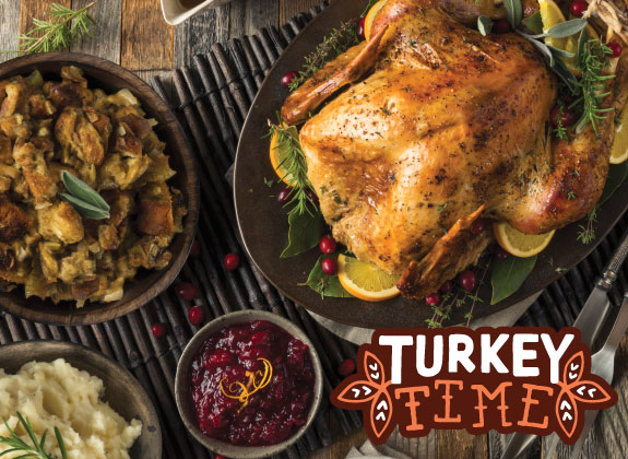 Turkey on a platter with HWFC Turkey Time illustrated logo in bottom right corner